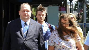 Scott Driscoll and wife Emma Driscoll on their way to the Brisbane District Court this week.