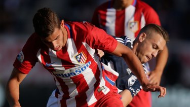 Atletico's Theo Hernandez runs the ball against Victory.