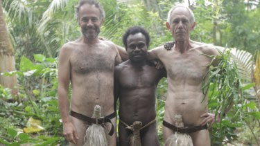 Traditional island dress: Tanna directors Bentley Dean (left) and Martin Butler with Lingai Kowia who appeared in the film.
