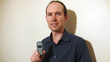 Small is all: Chris Woolmer has owned only one phone, a Nokia 2100 purchased in 2003.