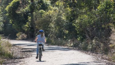 Riding the Great Southern Rail Trail.