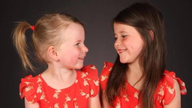 Ayla, 5, and Bria, 7, pose in a photo taken by Little Masterpiece Studio Pty Ltd.