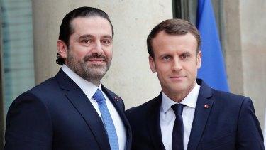 French President Emmanuel Macron greets Lebanon's Prime Minister Saad Hariri in Paris.