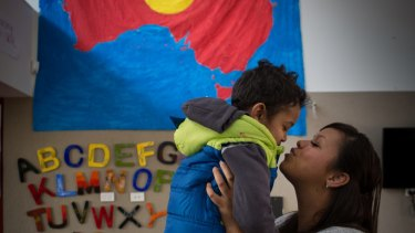 Djural Aldridge, 3, gets a kiss from mum Casey Tennyson at the Bubup Wilam Aboriginal child and family centre.