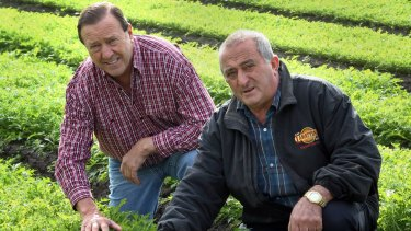 Lobster dinner host Frank Lamattina (right) with Liberal councillor Geoff Ablett at Mr Lamattina's farm.