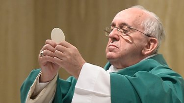 Pope Francis celebrates Mass at the Vatican's Santa Marta hotel on Monday.