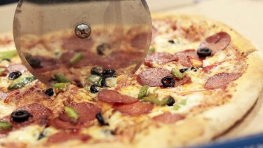 Domino's Pizza has been accused of taking a large slice out of franchisee profits.