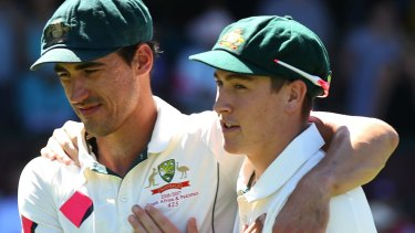 No guarantees: Mitchell Starc embraces Matt Renshaw after winning the third Test.