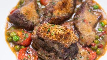 Agnello di Forno, baked lamb in white wine, chilli, garlic, herbs, tomato and peas.