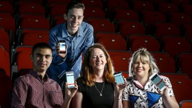 Dr Grainne Oates (front, centre) a senior lecturer in accountancy at Swinburne University, has developed an app that turns learning into a game. With students Batur Changez, Paul Divitcos and Nicchia Gray.