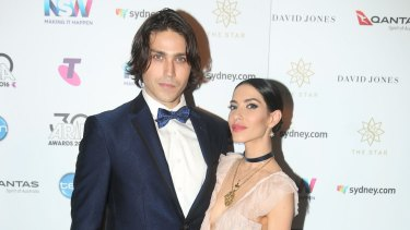 Lisa Origliasso and Logan Huffman pose in awards room during the 30th Annual ARIA Awards 2016 at The Star on November 23, 2016 in Sydney, Australia.