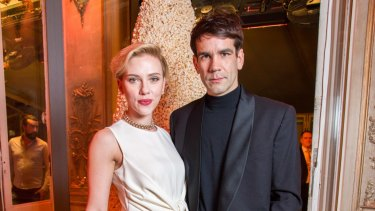 Scarlett Johansson and Romain Dauriac attend the Yummy Pop Grand Opening Party at Theatre du Gymnase on December 16, 2016 in Paris, France.