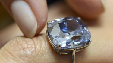 The rare Blue Moon diamond. The 12.03 carat blue diamond is the largest cushion shaped fancy vivid blue diamond  ever appear at auction.