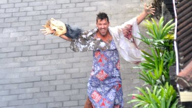 The prankster unveiled - Schapelle Corby's brother Michael removes his mask for the assembled media.