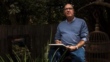 Artist Ian Sharpe sketching in his garden.