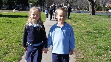 Tabitha Bobbin, 5, of Ainslie and Luke Jakubowski, 5, of Ainslie join fellow students of Ainslie Primary School participate in Winter Walk to School Week.