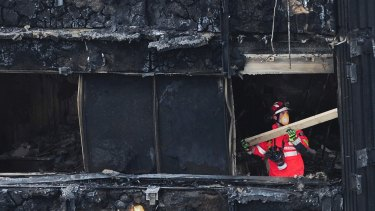 A London Fire Brigade officer inside the Grenfell Tower.