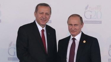 "Russian President Vladimir Putin is greeted by Turkish President Recep Tayyip Erdogan at the G20 Turkey Leaders Summit on November 15 in Antalya. Putin has called the Russian fighter's downing a ""stab in the back""."