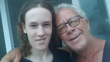 Retired WA police sergeant Graeme Johnson with his 15-year-old son in Sanur.