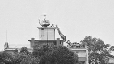A CIA employee (probably O.B. Harnage) helps Vietnamese evacuees onto an Air America helicopter from a rooftop near the US embassy in Ho Chi Minh City, then known as Saigon, in 1975.