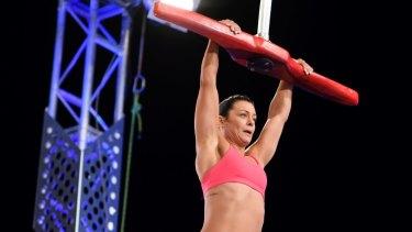 Jenna Douros attempts the silk slider during Australian Ninja Warrior heats.
