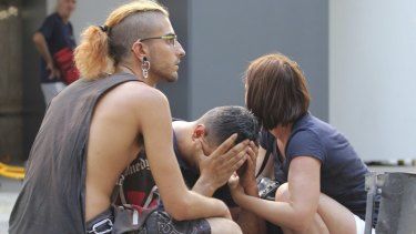 Injured people react after a van crashed into pedestrians in downtown Barcelona.