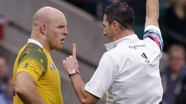 Controversial: Referee Craig Joubert speaks to Australia's captain Stephen Moore.