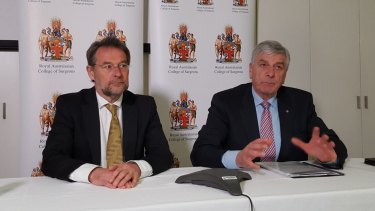Royal Australasian College of Surgeons president David Watters, left, and Rob Knowles, chairman of the college's expert advisory group on bullying.