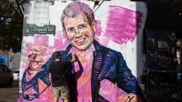 Artist Scott Marsh paints a mural of NSW Premier, Mike Baird holding a kebab and glass of wine. Initiatives by the Baird government, such as a recent roundtable to develop policies for improving the city's night life, have been welcomed by businesses.