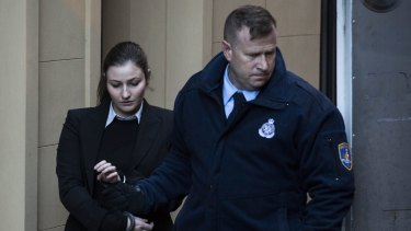 Harriet Wran is escorted into a prison van after being sentenced.