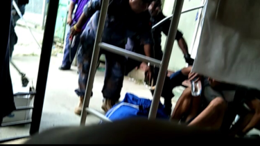 Video sent to Fairfax Media from inside the camp showed police armed with long sticks.