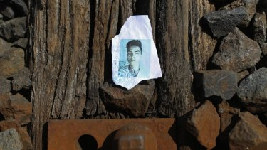 A discarded, torn and ripped identity document of a migrant sits on the railway tracks as hundreds of migrants and refugees continue to cross the border from Serbia into Hungary.