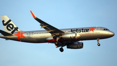 Jetstar have offered the couple $50 vouchers each while it investigates the alleged on-board behaviour by another passenger.