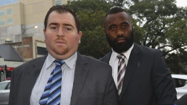 Semi Radradra, right, charged with domestic violence, arrives at Parramatta Local Court with an unidentified man on Tuesday.