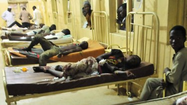 Injured males in hospital following the explosion in Kano, Nigeria, where a suicide bomber exploded as people were tucking into dinner.