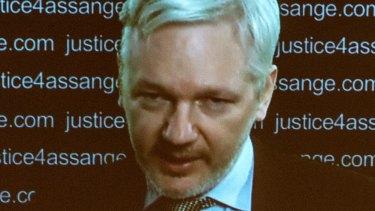 Julian Assange speaks via video link from the Ecuadorian Embassy in London.