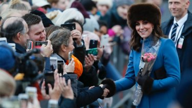 Kate Duchess of Cambridge is greeted by spectators in front of the Norwegian Royal Palace in Oslo.