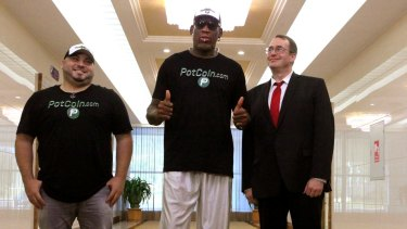 Former basketballer Dennis Rodman (centre) arrives in the North Korean capital Pyongyang on Tuesday.