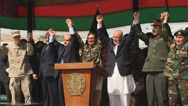 Afghan President Ashraf Ghani, to the right of the podium, is joined by top US and Afghan military leaders for the launch of the Afghan Army's new special operations corp on Sunday.