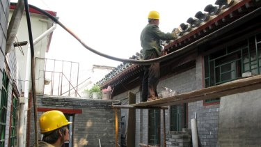Beijing authorities are trying to curb real estate prices by limiting the number of properties residents can own.