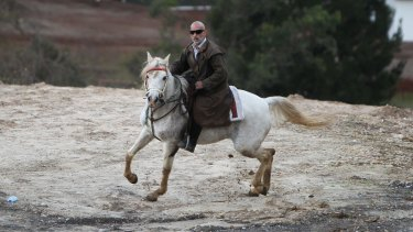 Mamdouh Elomar goes for his ride on his family property at Denham Court near Campbelltown on Tuesday.