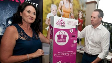 Share the Dignity's Rochelle Courtney and Housing Minister Mick de Brenni with a Pink Box.