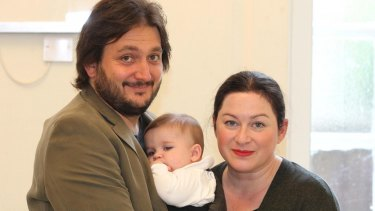 Hicks with husband Karl and daughter Amelie.