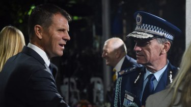 Police Commissioner Andrew Scipione - at the Anzac Day Dawn Service with NSW Premier Mike Baird on Monday - announced the arrest shortly after the service began.