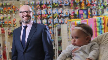 Baby Bunting CEO Matt Spencer and one of his customers, baby Anika.