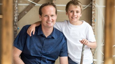 Scott Moffat with his son during the renovation.