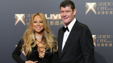 Golden couple: James Packer and Mariah Carey pose on the red carpet at Melco Crown's Studio City opening night in Macau.
