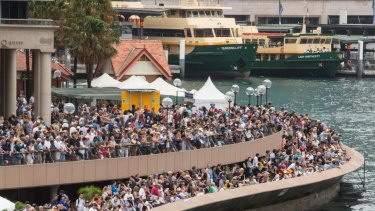 Crowds of people gather on the foreshore of Sydney Cove on Australia Day.