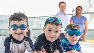 Six year old twins Joey and Ben get ready for swimming lessons at Ian Thorpe Pool in Ultimo.