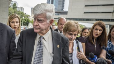 Geoff and Priscilla Dickie, father and mother of Alison Baden-Clay, leave Brisbane Supreme Court after Gerard Baden-Clay's murder conviction was downgraded to manslaughter.